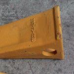 Коронка 6112470M1 для ковшей экскаваторов-погрузчиков TEREX TLB840